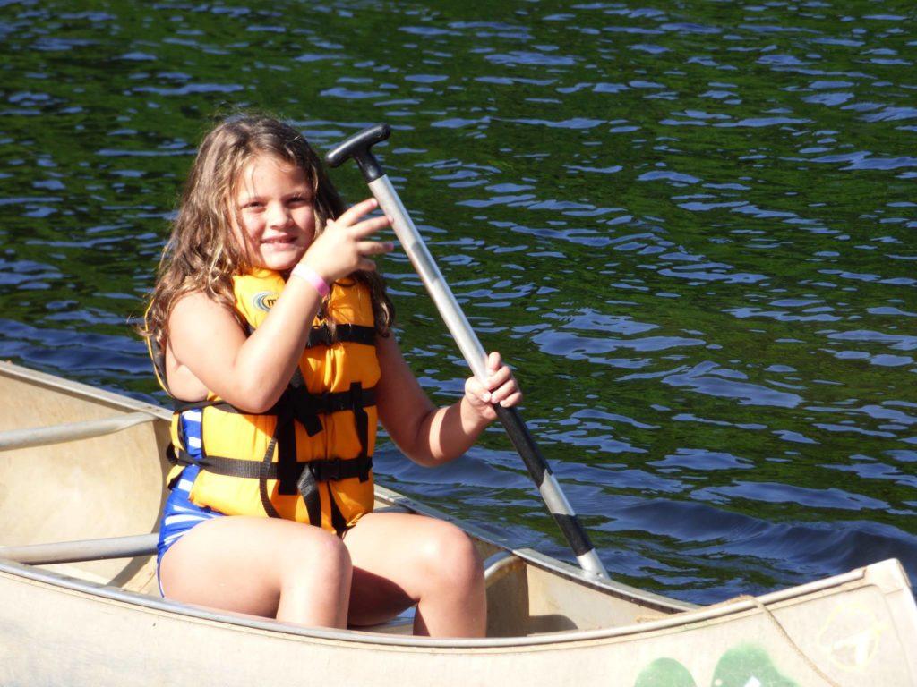girl in canoe on lake