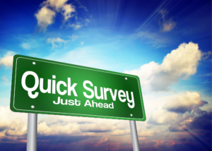 picture of sky with billboard say quick survey just ahead